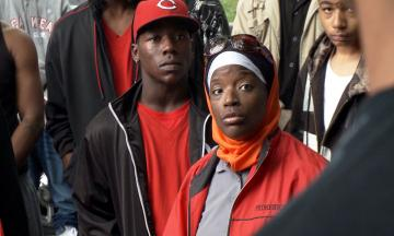 """Ameena Matthews is surrounded by a crowd in """"The Interrupters"""""""