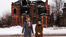 Performance artists is gas masks use decaying Detroit as a backdrop in a scene f