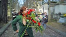 "Denis Lavant chomps cemetery flowers in ""Holy Motors"""